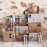 Childrens craft project making a city from cardboard boxes
