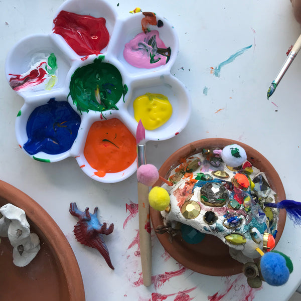painting a clay kids sculpture