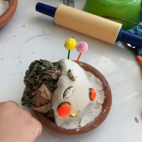 child moulding clay