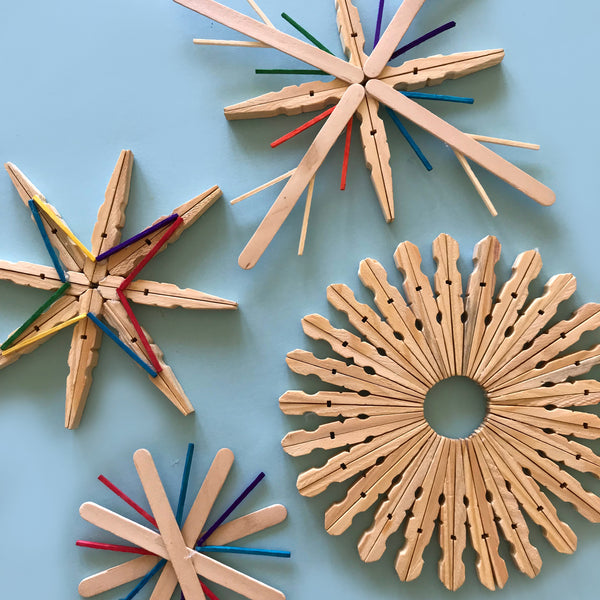 Wooden Christmas snowflakes made from clothes pegs