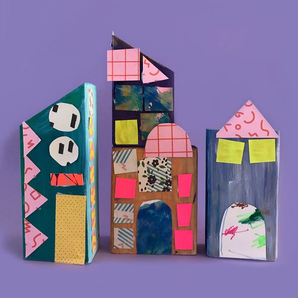 wooden blocks with collage materials made into houses