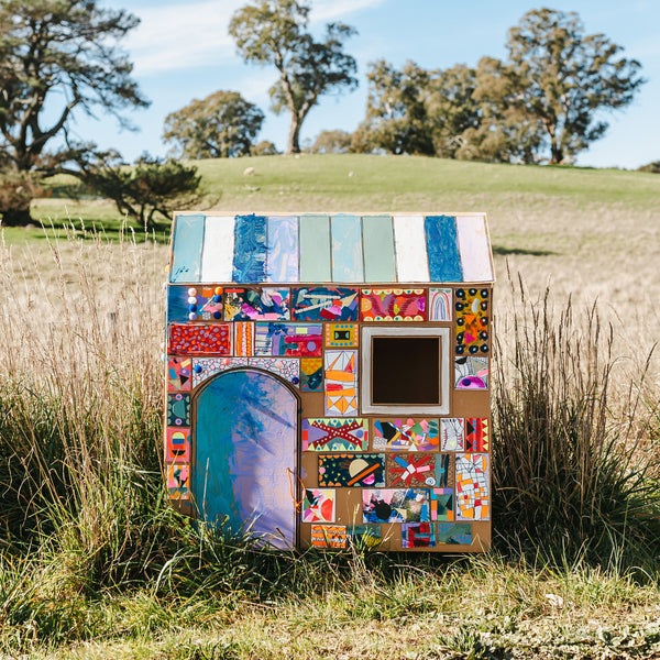 cardboard box cubby house, a craft project from unboxed, a children's craft book by Mini Mad Things