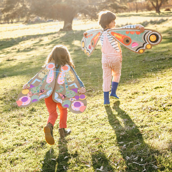 children playing cardboard butterfly wings, a project from unboxed, a children's craft book