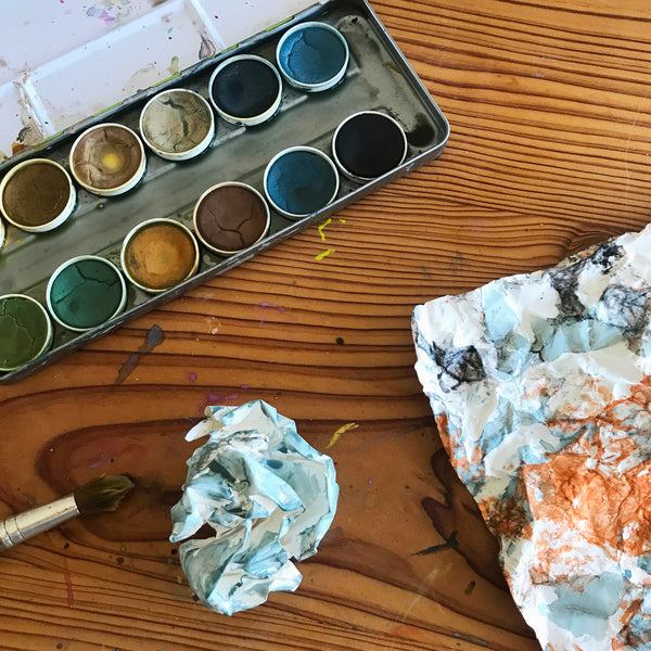 crumpled paper and natural watercolour paints