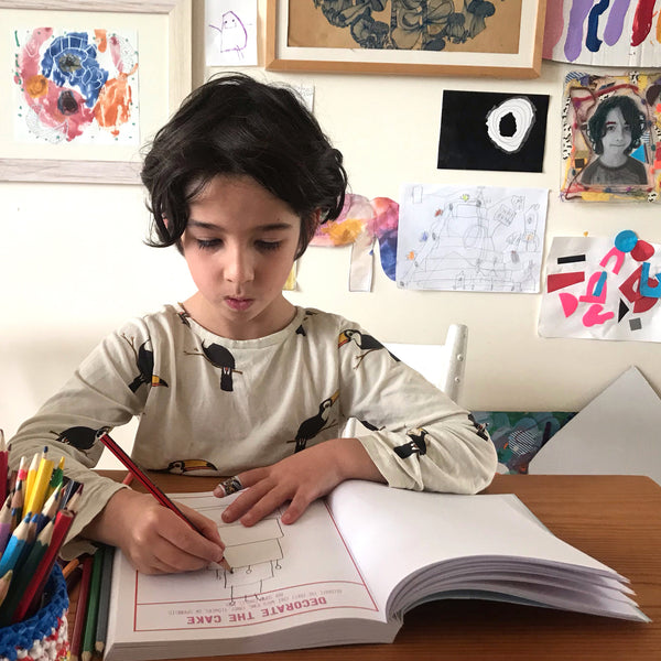 child drawing in the book invitation to draw