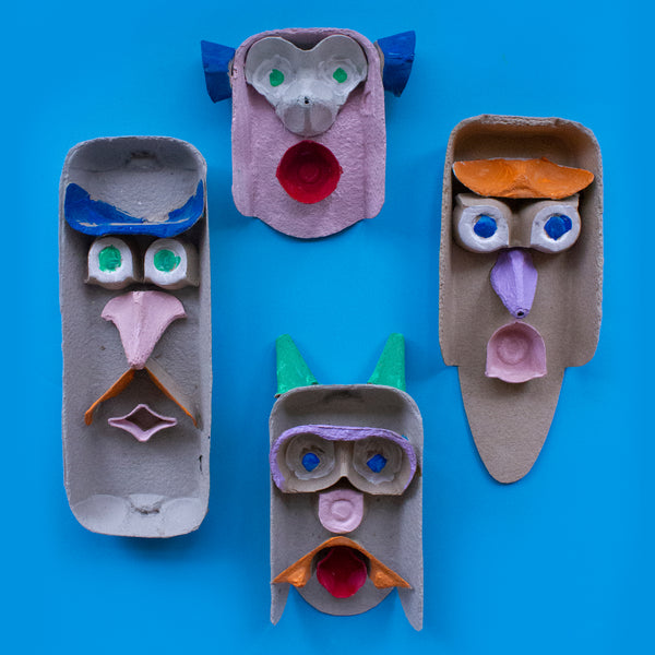 fin painted heads made from up-cycled egg cartons