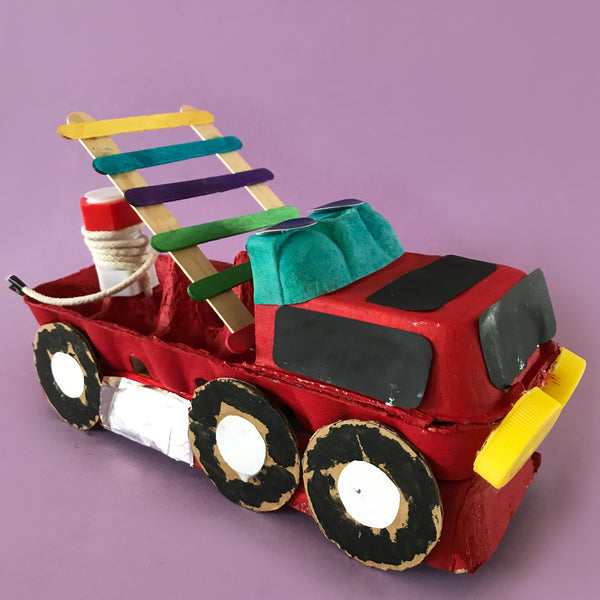 Kid craft project fire engine made using an egg carton