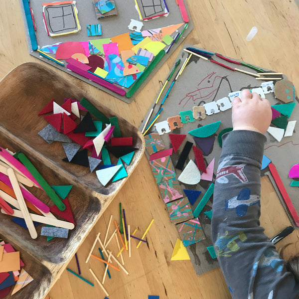 A child creating a house collage artwork