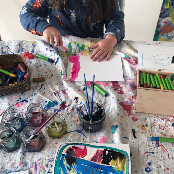 child painting with water colour paints