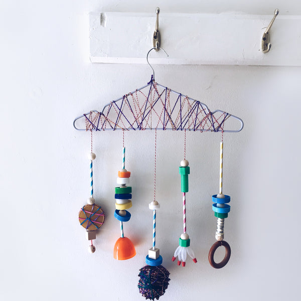 Up-cycled junk mobile kids craft hanging on a hook