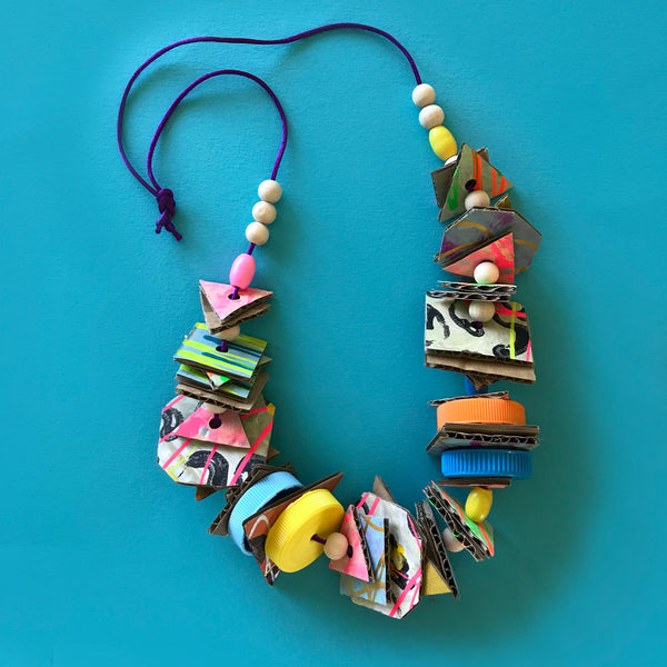 Fun kids jewellery made using cardboard and bottle tops