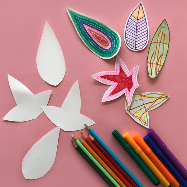 Paper leaf shapes coloured in by children