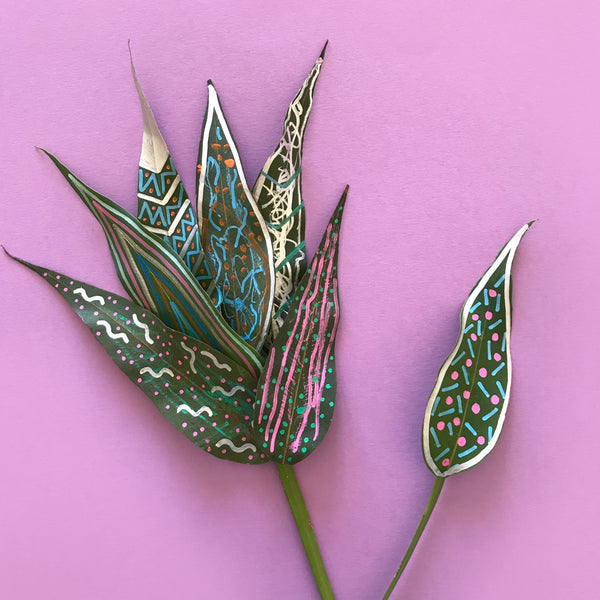 painted leaves aranged into a flower shape