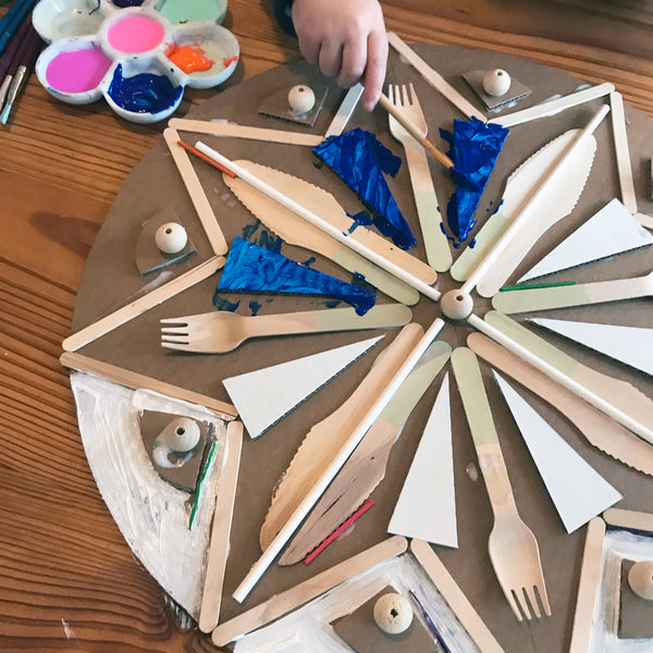 child painting a cardboard collage mandala craft project