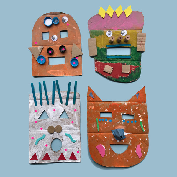 Cardboard monster masks made by children