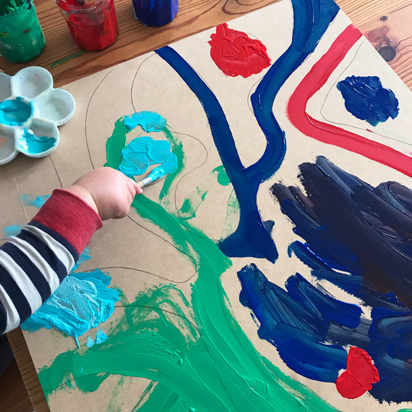 Child painting on an mdf board