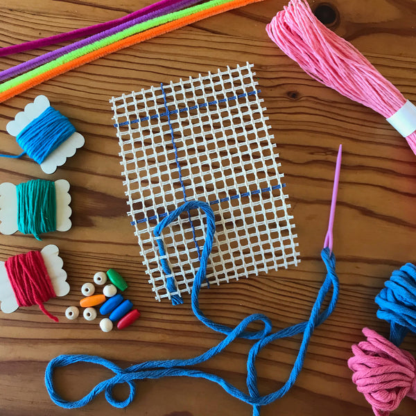 Mesh base and yarn for a kids weaving project