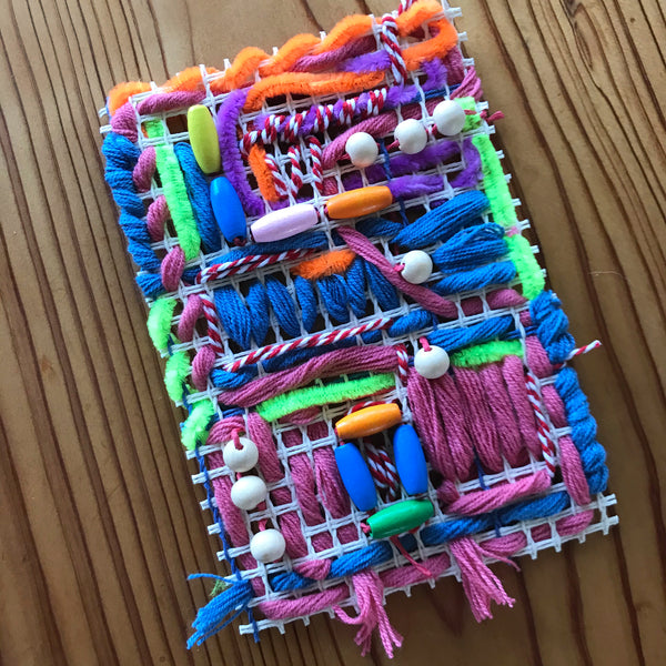 Mixed medis kids weaving project with yarn, pipe cleaners and wooden beads
