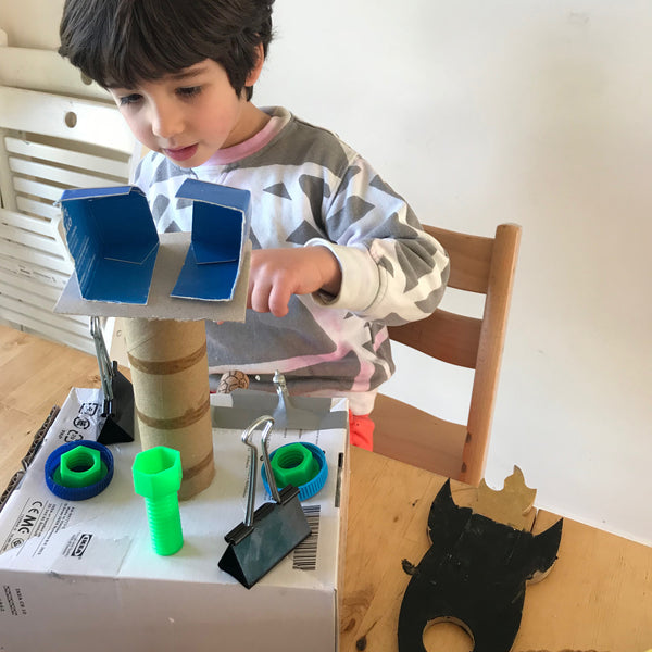 Child building with junk materials