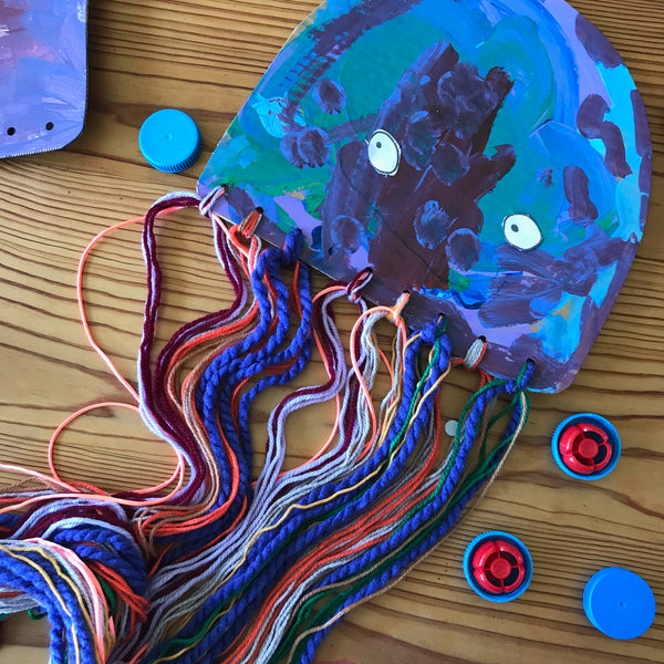 Painted jellyfish craft with colourful yarn tenticles