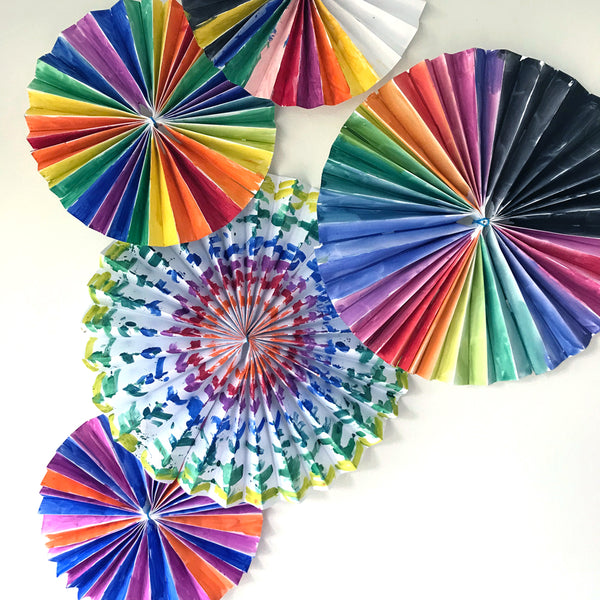 rainbow colour painted pinwheel party decorations