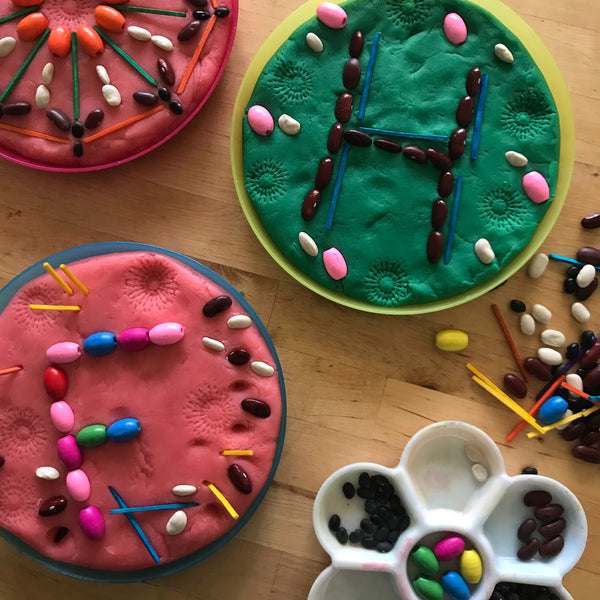 letter shapes made with beans in playdough