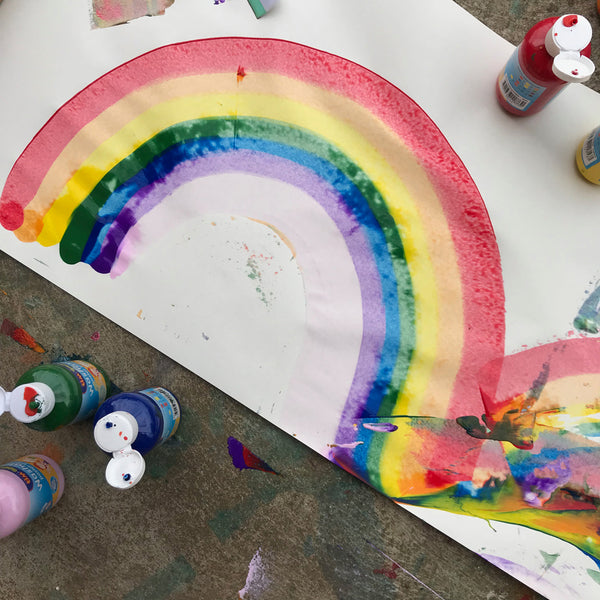 rainbow painted on a large piece of paper