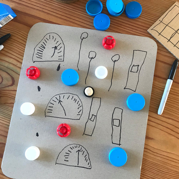 cardboard and bottle top buttons and dials for a robot