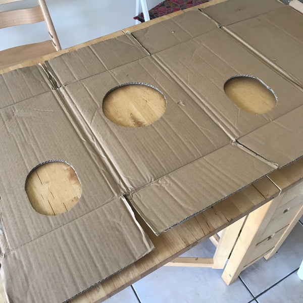 Cardboard box to make a rocket dress up costume