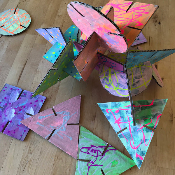 colourful painted cardboard building shapes