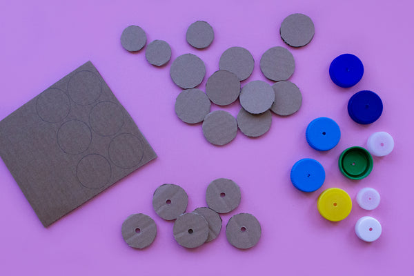 cardboard discs and bottle tops