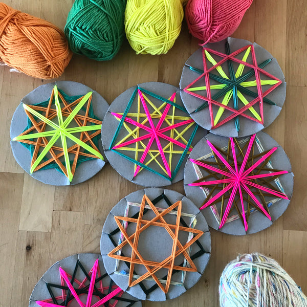 Wrapped colourful yarn star christmas decorations