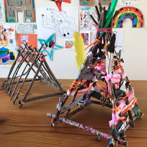 Mini tee pee made using sticks, fabric and elastic bands
