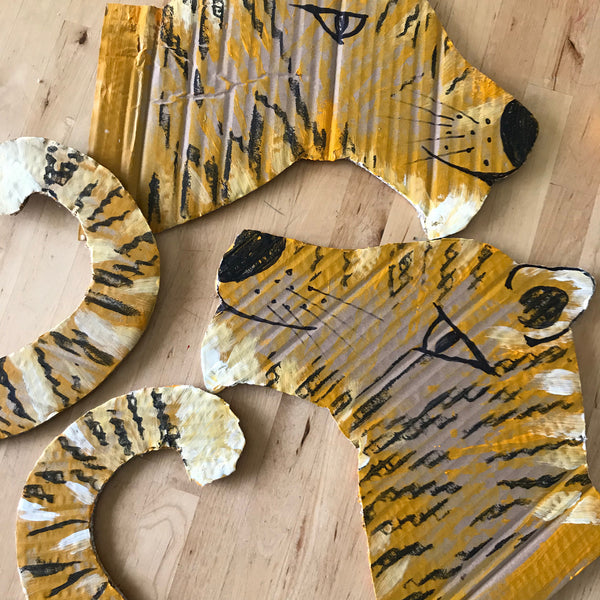 painted cardboard tiger head and tail