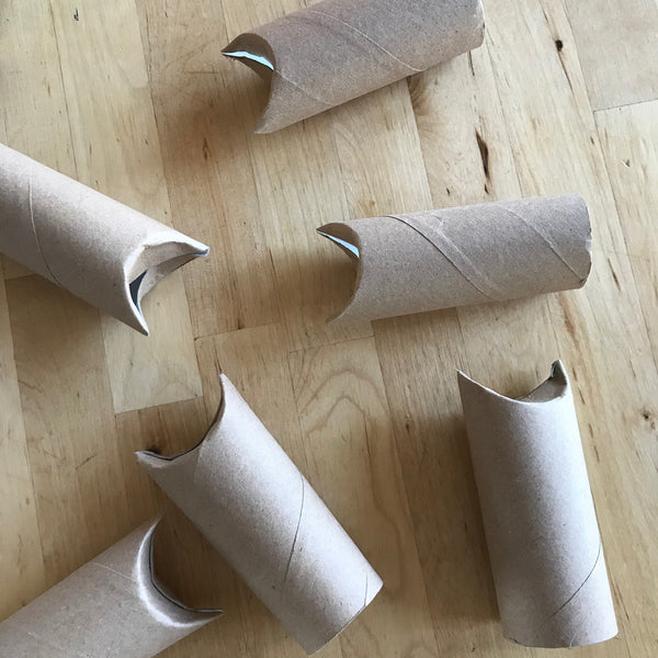 cardboard toilet roll tubes with the ends folded over