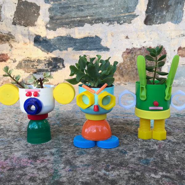 up-cycled plastic bottle top plant pots made from plastic lids