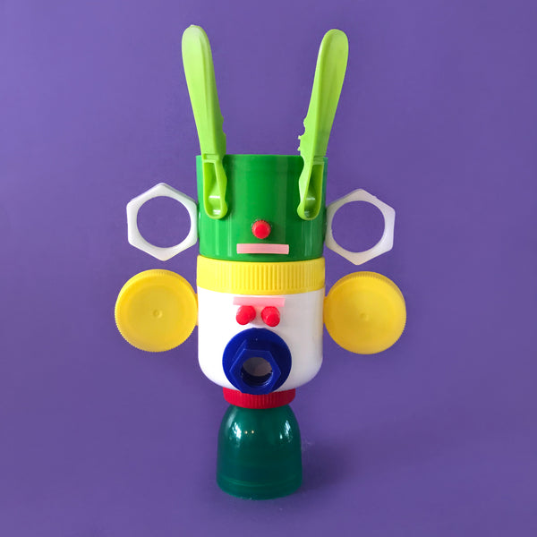 stacking totem toy made from recycled plactic lids