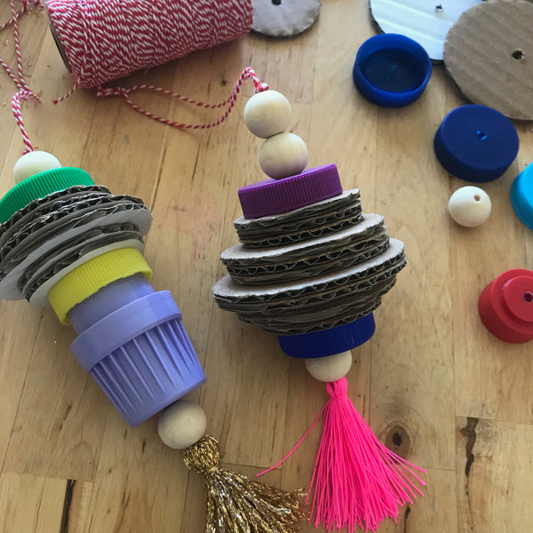 up-cycled christmas decorations made using cardboard and bottle tops