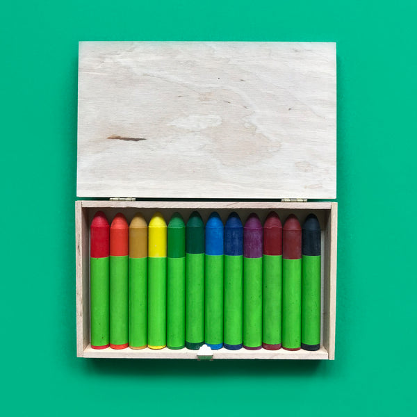 Eco-friendly natural bees wax crayons in a wooden box