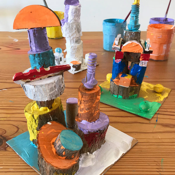 Colourful painted wooden art sculptures by kids