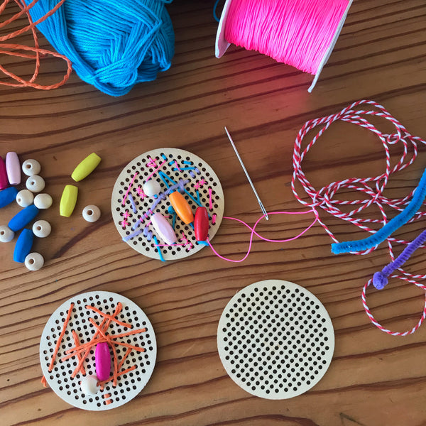 embroidery yarn and wooden discs on a table
