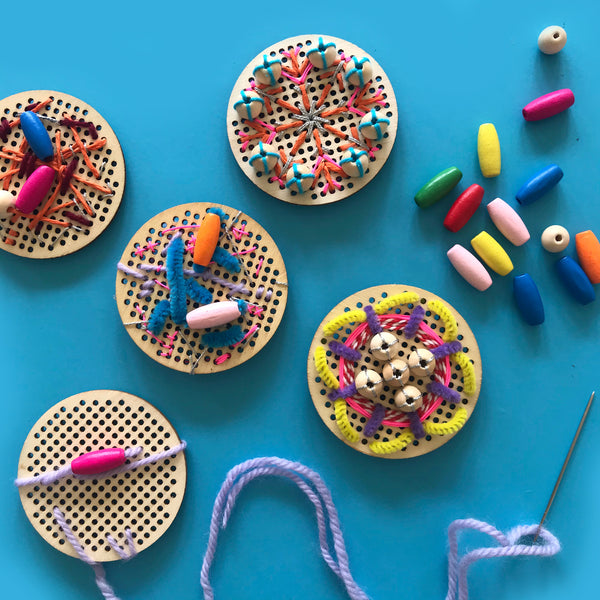 kids embroidery on wooden perforated discs