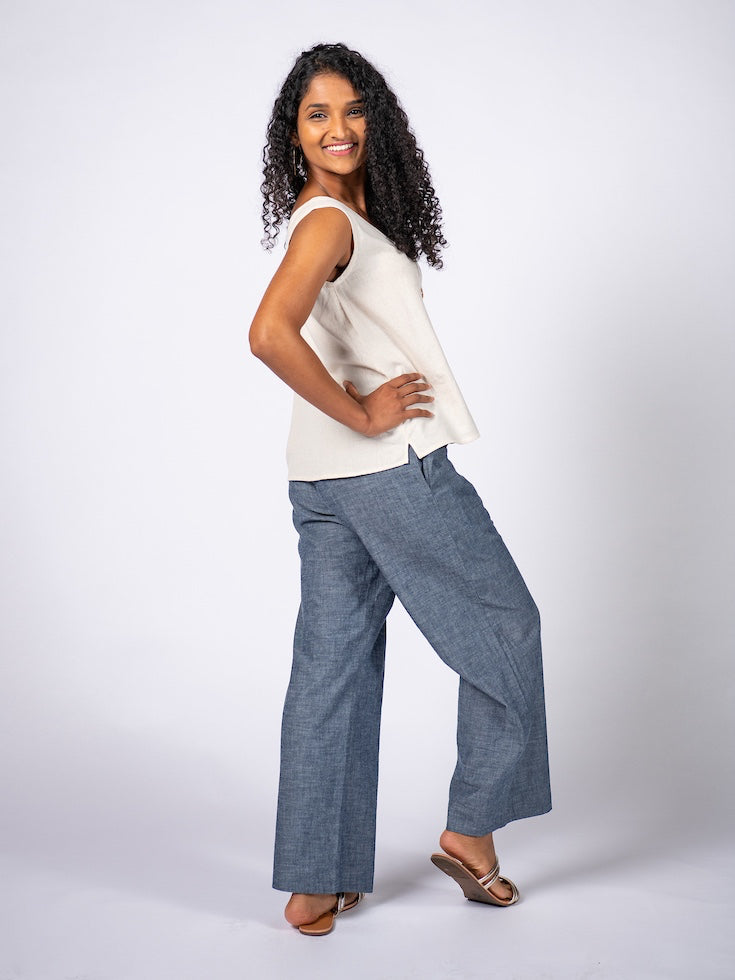 Swahlee creates a handmade capsule wardrobe of clothing essentials made in India using sustainable production and natural fabrics. The Wide Leg Trousers in Chambray.