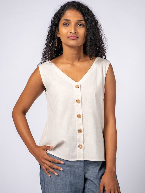 Swahlee creates a handmade capsule wardrobe of clothing essentials made in India using sustainable production and natural fabrics. The Sleeveless Reversible Top in Natural Cotton Linen..