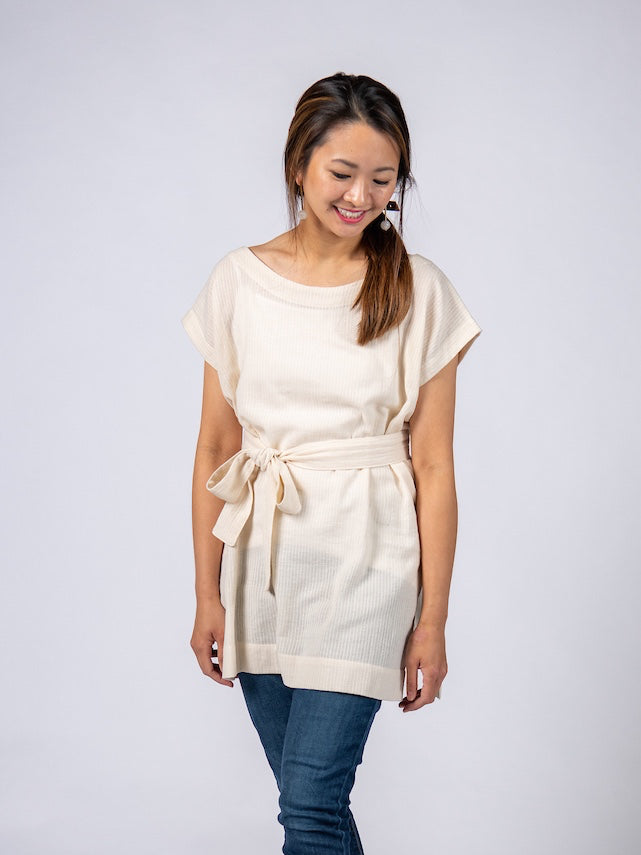 Swahlee creates a handmade capsule wardrobe of clothing essentials made in India using sustainable production and natural fabrics. The Kaftan Tunic in Sheer Striped Natural.
