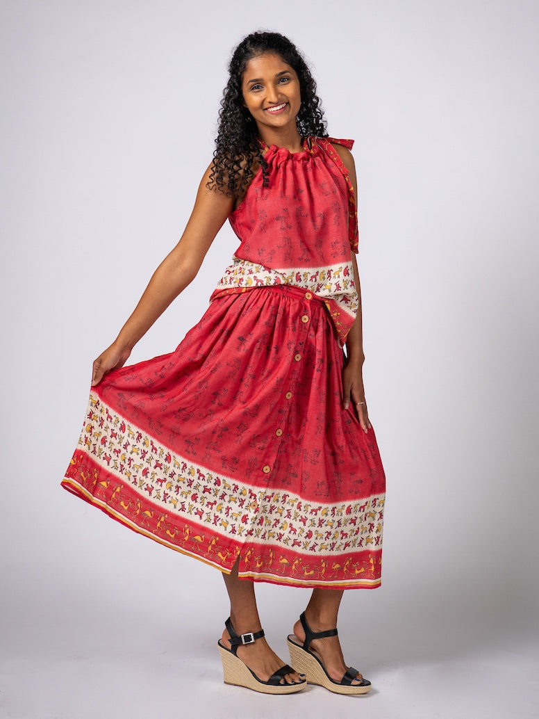 Swahlee creates a handmade capsule wardrobe of clothing essentials made in India using sustainable production and natural fabrics. The Upcycled Sari Button Midi Skirt.