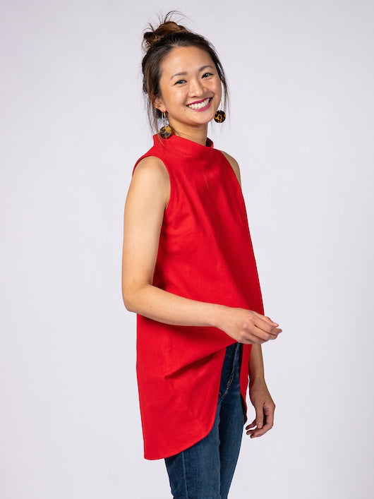 Swahlee creates a handmade capsule wardrobe of clothing essentials made in India using sustainable production and natural fabrics. The Stand Collar Tunic in Red.