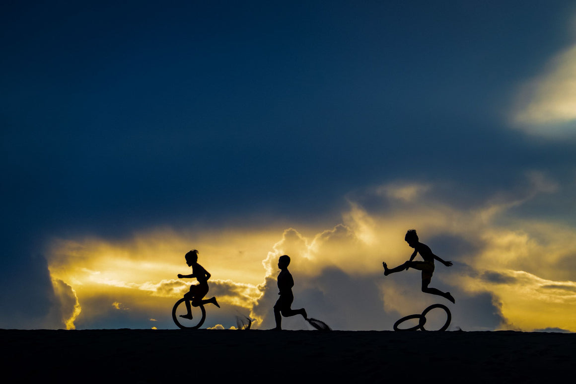 Children play with joy in the first light of dawn.