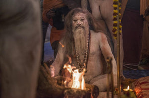 Sadhus  seated around campfires