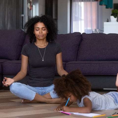 Woman meditating with child